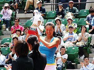 Kimiko Date - Date holding the trophy at the Tokyo Ariake International Ladies Open in 2008