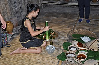 Kadazan-Dusun - Traditional rice wine been served by using bamboo as a drink cup in Kota Kinabalu, Sabah, Malaysia. This is part of the Kadazandusun cuisine.
