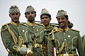 Kuwaiti soldiers wait to participate in their National Day military parade.jpg