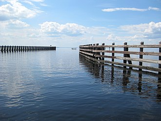 Channel (geography) - Wooden pilings mark the navigable channel for vessels entering Lake George from the St. Johns River in Florida.