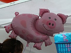 Pig-related souvenirs and balloons