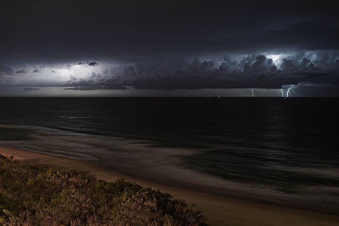 Lightning storm over ocean at night.jpg