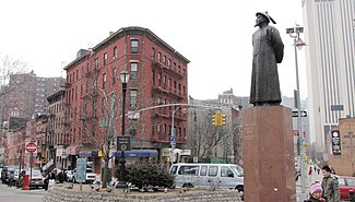 Kimlau Square, a park located in Chatham Square; on left is Oliver Street; on right is St. James Place; the statue is Lin Zexu