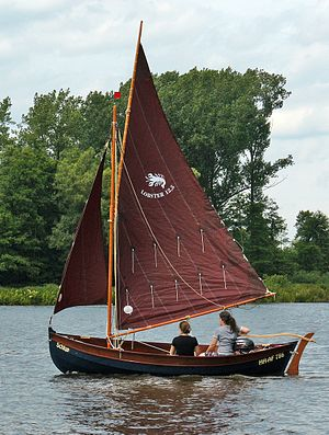 Gunter - Gunter rigged boat with two reefing lines reeved through the sail