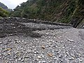 Long cliff formed by riverbank erosion at the Danda and Zhuoshui confluence on 16th October 2020.jpg