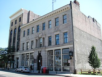 WFNX - The studios and offices of WFNX were located on the second floor of 25 Exchange Street in Lynn, with the station's studio/transmitter link antenna mast on the roof.