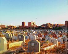 Cimitero musulmano al tramonto a Marrakech, Marocco.