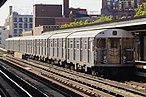 A train made of R32 cars in J service departing Lorimer Street, bound for Manhattan.