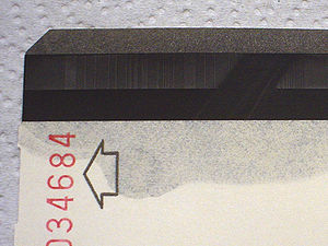 Magnetic developer - An example of damaged magnetic encoding. A magnet was run across this stripe. The encoding has been made visible by applying a Magnetic Developer solution