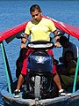 Man with Motorbike on Launch - Flores - Peten - Guatemala (15837098946).jpg