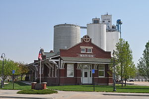 Marion, Kansas - Marion Library, in former Santa Fe depot (grain elevator in background) (2011)