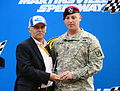 Martinsville Speedway President Clay Campbell presents Army Sgt. 1st Class Matthew Solomon, an operations sergeant for the XVIII Airborne Corps, with an honorary starter statue, at the Tums Fast Relief 500 121028-A-ZZ999-001.jpg