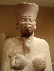 180px-MentuhotepII-FuneraryStatue-CloseU