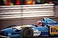Michael Schumacher - Benetton B195 braking for Copse at the 1995 British Grand Prix, Silverstone (49728320617).jpg
