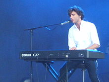 Mika playing keyboard at V Festival 2007.JPG