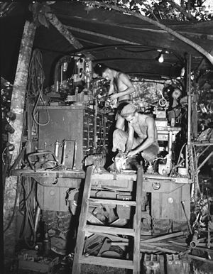 Machining - New Guinea in 1943. Mobile machine shop truck of the US Army with machinists working on automotive parts