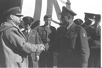 E. L. M. Burns - December 16, 1956, IDF Chief of Staff Moshe Dayan and Major-General E. L. M. Burns end their meeting at Lod airport set to discuss further withdrawal of Israeli troops from Sinai.