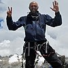 Mostafa Salameh raising seven fingers on completion of the last of the Seven Summits