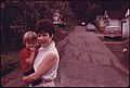 Mrs. Sharon Bowling, 25, and Son, Mark, 2, in the Street Outside Their Home in Cumberland, Kentucky 10-1974 (3907245068).jpg