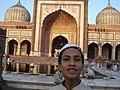 Muslim boy at Jama Masjid Mosque (50691790).jpg