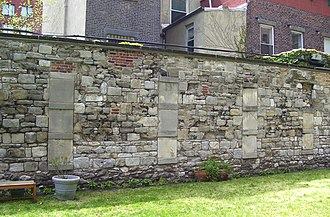 New York Marble Cemetery - Part of the south wall, showing the embedded marble tablets