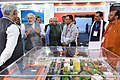 "Narendra Modi visiting an exhibition on Flagship Missions of Urban Development during the event ""Transforming Urban Landscape Third Anniversary of Pradhan Mantri Awas Yojana (Urban).JPG"
