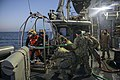 Navy divers search for a downed helicopter crewman. (11934731726).jpg