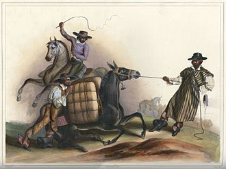 Arriero - Arrieros (1836) by Carl Nebel;  three Mexican muleteers attempting to move a heavily loaded mule