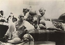 Jawaharlal Nehru sitting next to Gandhi at the AICC General Session, 1942