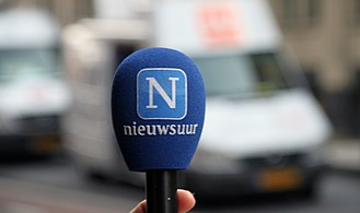 Nieuwsuur - Reporters microphone.