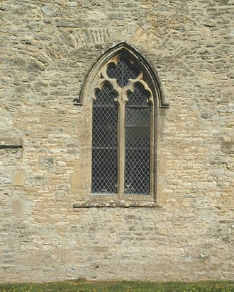 St Mary's Church, North Leigh - 11th-century Anglo-Saxon arch blocked since the 12th century, with Decorated Gothic window added in the 14th century.