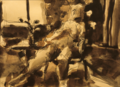 Nude sitting in a chair by Christopher Willard.png