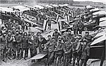Officers of No 1 Squadron, RAF with SE5a biplanes at Clairmarais aerodrome, near Ypres, July 1918.jpg