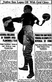 From a newspaper, Kuhn in uniform, throwing a football