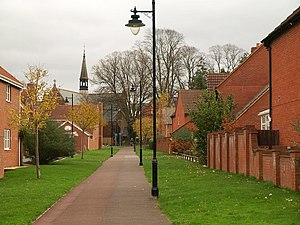 Cotford St Luke - Path running through the village, with the Chapel pub in the distance.