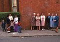 People divided by race watching protest march in Leicester England 1974.jpg