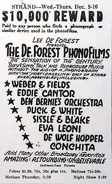 "All-text advertisement from the Strand Theater, giving dates, times, and performers' names. At the top, a tagline reads, ""$10,000 reward paid to any person who finds a phonograph or similar device used in the phonofilms."" The accompanying promotional text describes the slate of sound pictures as ""the sensation of the century...Amazing! Astounding! Unbelievable""."