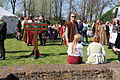 Pillory and seated people during april 1 event Brielle.JPG