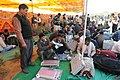 Polling officials checking the Electronic Voting Machines (EVM`s) and other necessary inputs required for the Assembly Election in Rajasthan, at a distribution centre, in Jaipur, Rajasthan on November 30, 2013.jpg