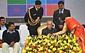 Pranab Mukherjee launching 'Sajag'- a Smartphone App on Energy Education, at Dr. Rajendra Prasad Sarvodaya Vidyalaya, President's Estate, in New Delhi. The Chief Minister of Delhi, Shri Arvind Kejriwal is also seen.jpg