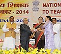 Pranab Mukherjee presenting the National Award for Teachers-2014 to Smt. Krairi Mog Choudhury, Tripura, on the occasion of the 'Teachers Day', in New Delhi. The Union Minister for Human Resource Development.jpg