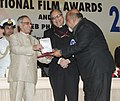 Pranab Mukherjee presenting the Rajat Kamal Award for Best Supporting Actor Jolly LLB (Hindi) to Shri Saurabh Shukla, at the 61st National Film Awards function, in New Delhi. The Secretary.jpg