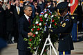 President Barack Obama, left foreground, places a wreath at the Tomb of the Unknowns with the help of a U.S. Army honor guard Soldier at Arlington National Cemetery in Arlington, Va., during a Veterans Day 131111-D-DB155-003.jpg