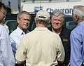 President George W. Bush receives a briefing from Chevron Refinery Manager Roland Kell.jpg