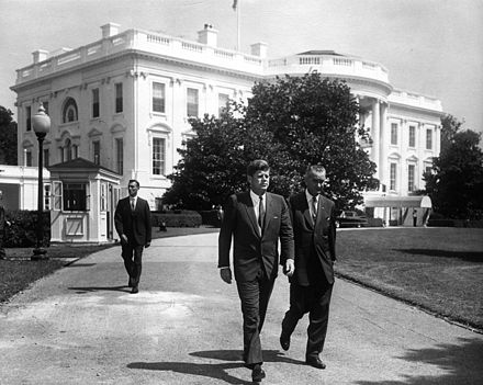 President Kennedy and Vice President Johnson stroll outside the White House prior to a ceremony President Kennedy and Vice President Johnson prior to ceremony.jpg
