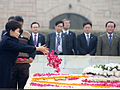 President Park Geun-hye (left) pays her floral respects during a visit to the memorial to Raj Ghat.jpg