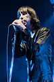 Colour photograph of Bobby Gillespie singing live in 2009.