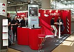 Red Hat at the 2004 LinuxTag conference and exhibition in Karlsruhe, German.jpg