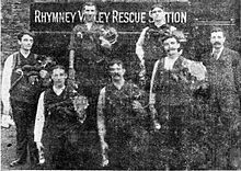 Seven rescuers pose in front of the Rhymney Rescue Station.