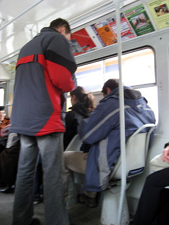 Penalty fare - A ticket inspector in informal clothing in a tram in Brno